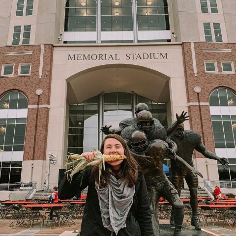 Taylor DeMaro in front of Memorial Stadium